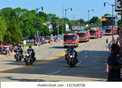 Racine, Wisconsin / USA - July 4, 2018: Racine Police and Fire Departments at the start of the Fourth of July Parade.