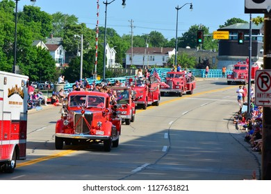 Racine, Wisconsin / USA - July 4, 2018: A line of old fire trucks at the Racine Parade.