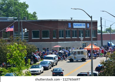Racine, Wisconsin / USA - July 4, 2018:  Crowds line the streets for the Fourth of July Parade.