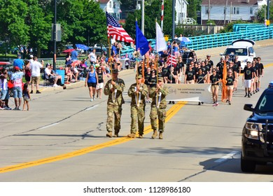 Racine, Wisconsin / USA - July 4, 2018: Racine Lighthouse Brigade marching along Main Street, behind a Military Colorguard, during the parade celebrating the Fourth of July.