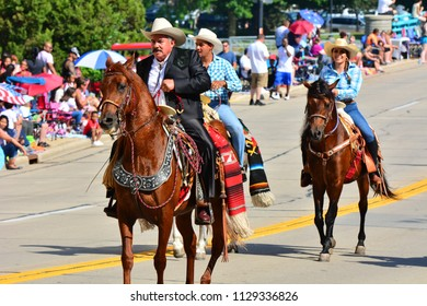 Racine, Wisconsin / USA - July 4, 2018: Horses in the Racine Parade orange along the route.