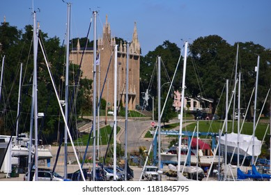 Racine, Wisconsin / USA - September 17, 2018:  A view of Saint Patrick's Catholic Church through the sailing masts along the Root River.