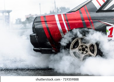 racing car drift in smoke of rubber