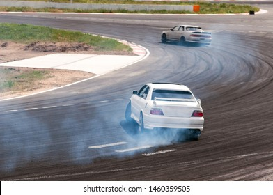 racing car in a skid. drift, tire smoke. sports car. extreme sport