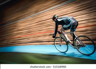 Racing cyclist on velodrome