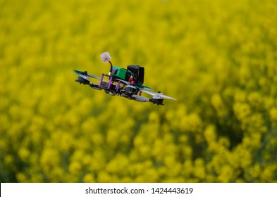 Racing drone hovering from behind