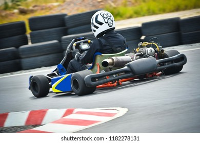 Racing karting competition on a racetrack