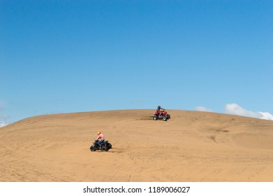 Racing with quadricycles at the sand dunes