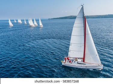 Racing sail boat from bird view, many of sailing boats in background