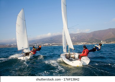 Racing Sailboat in the sea on a sunny day