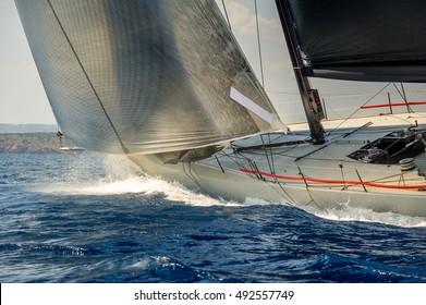 Racing sailing yacht going fast in the Mediterranean sea. Sardinia island race, Italy
