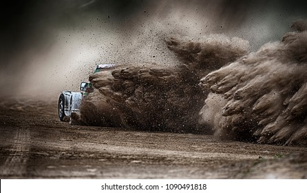 racing sports car in dust clubs on the track  , rally