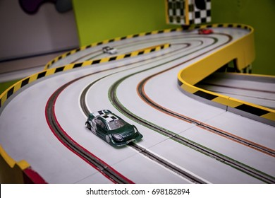 Racing track for toy carts