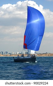 Racing yacht with blue spinnaker