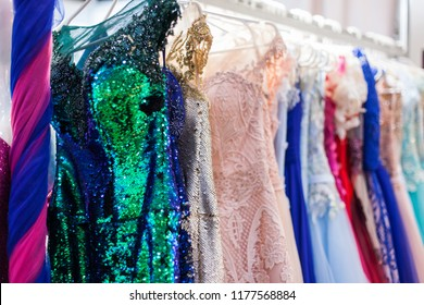 Rack with beautiful evening dresses in the clothing store.