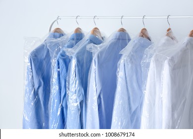Rack with clean shirts in laundry