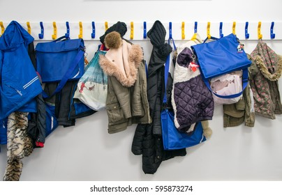 Rack of coats on pegs