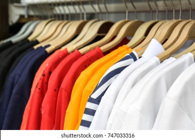 Rack with different t-shirts in modern shop