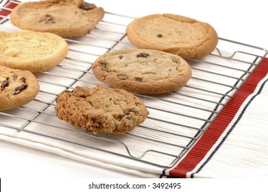 Rack of fresh baked cookies laid out to cool.