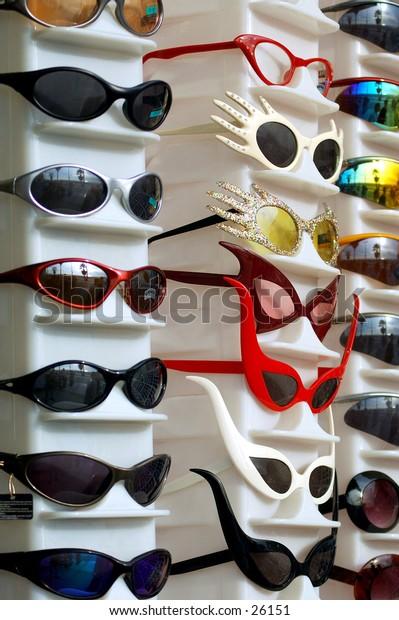 A rack full of fanciful super hero sunglasses