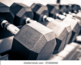 Rack of hand free weight dumbbells at a healthclub gym