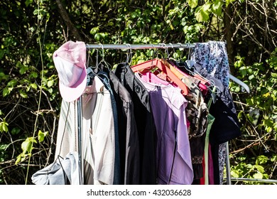 fba35fb1d rack of old fashion female clothes on display for charity