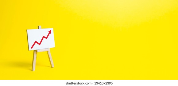 Rack with a red arrow up on a yellow background. Business planning and revenue analysis. Indicators of business projects, level of profitability, liquidity. Increase efficiency, productivity. banner