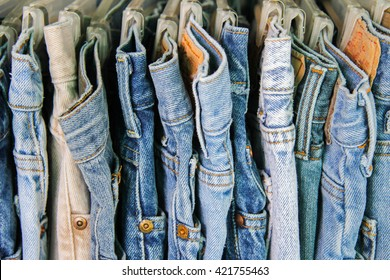 A rack of second hand jeans