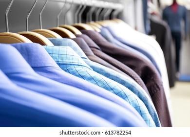 Rack with shirts in modern shop, closeup