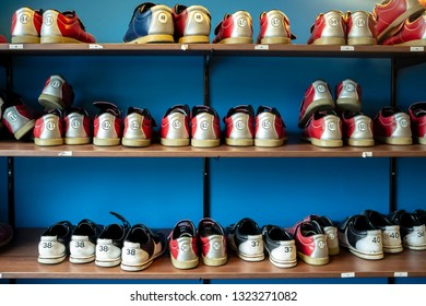 Rack with shoes for bowling of different sizes. Close-up.