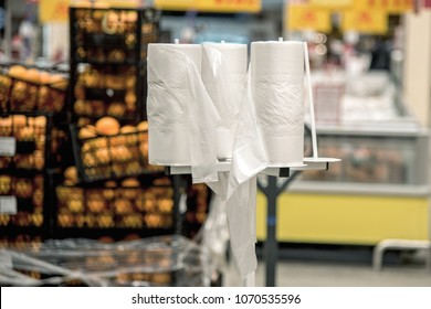 Rack Stand with free plastic bags - cellophane package in the supermarket store. Environmental pollution