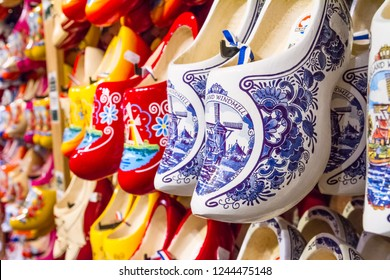Rack in the store with rows traditional dutch wooden shoes - klompen (clogs), closeup, the Netherlands