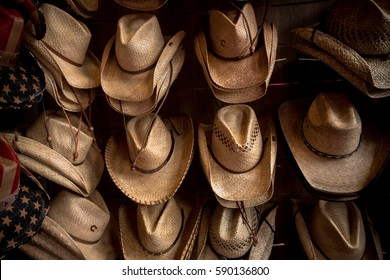 Rack of straw cowboy hats