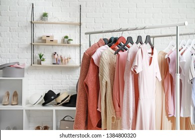 Rack with stylish clothes in dressing room