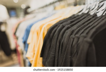 Rack with t-shirts in clothing store.