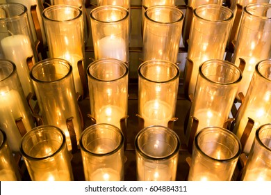 Rack of White Votive Candles