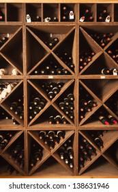A rack of wine bottles in a wine cellar.