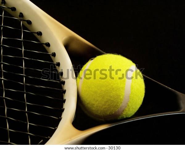 Racket and tennis ball.
