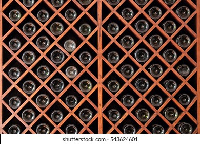 Ordinaire Racks With Bottles In A Wine Cellar.