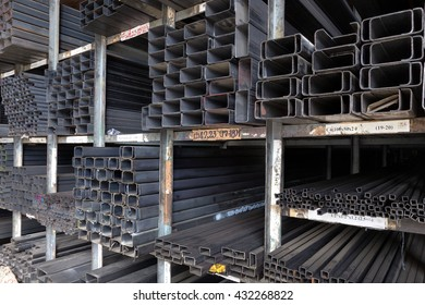 Racks of construction steel pipes in rectangle shape, various sizes, thickness, and weight