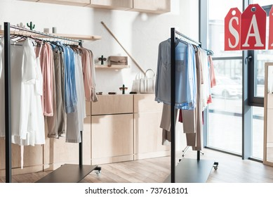 Racks with womens and mens clothes in a shop
