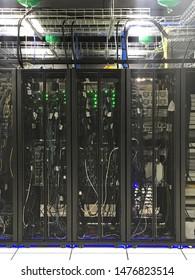 Rackserver cabinets and hardwares in an internet big data center room.