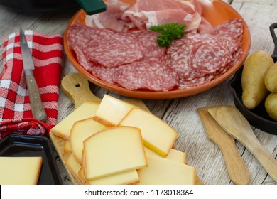 raclette cheese and assorted delicatessen