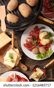 raclette cheese with meat and potato