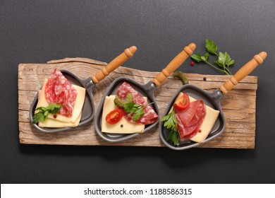 raclette cheese on spoon