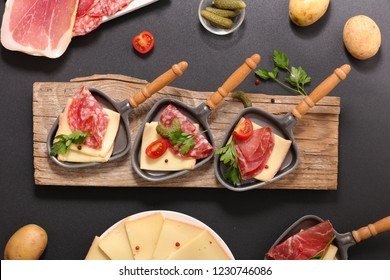raclette cheese with salami