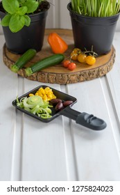 Raclette pan with various vegetables