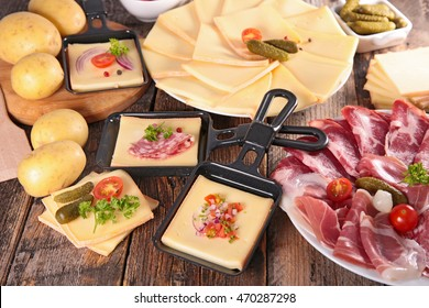 raclette party with cheese,potato and meat