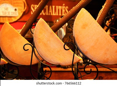Raclette (traditional melted cheese dish) stall at Christmas market in Paris.