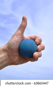 Racquetball Player Giving Thumbs Up Against the Sky